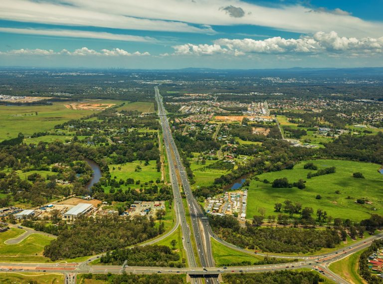 Aerial view of Caboolture and Bruce highway to Brisbane with Bri