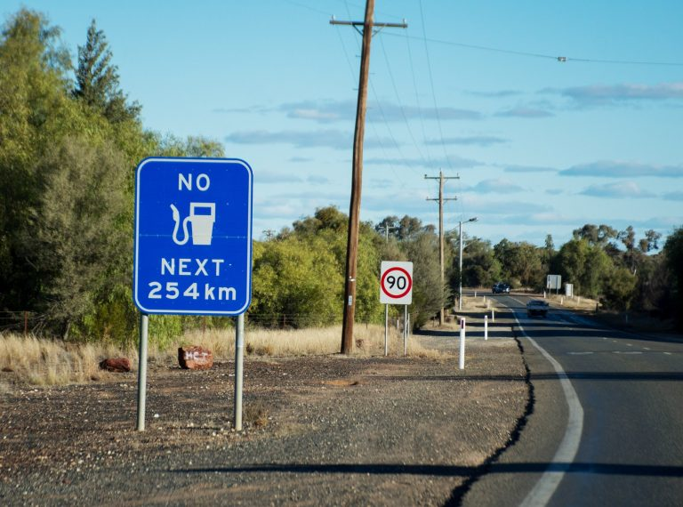 """Reality of Australian Outback. """"No fuel next 254 km"""" sign. Cobar, New South Wales, Australia."""